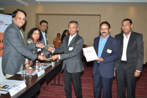 Mr. Mayank Bhatnagar, Director, Human Resources, WIPRO GE Healthcare, accepts the award with members of his team.